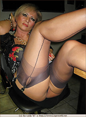Nasty MILF shows off her swollen tits, panty pussy and nylon legs for sex
