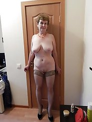 Sweet mature whore posing totally undressed
