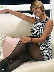 Enchanting old housewife is posing seminaked on photo