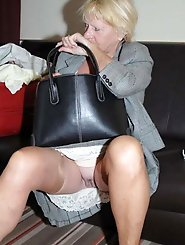 Alluring older dame playing with her cunt