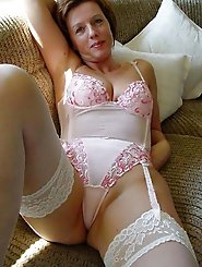 Attractive mature housewife spreading her pussy