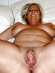 Dazzling mature whore is touching herself