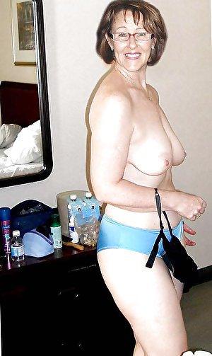 Elegant mature gilf taking off her dress