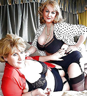 Aged girls posing undressed