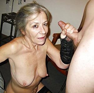 Older businesswomen posing nude outdoors
