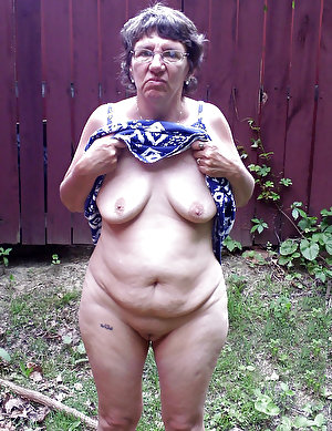 Old woman in leather black belts is looking so sweet